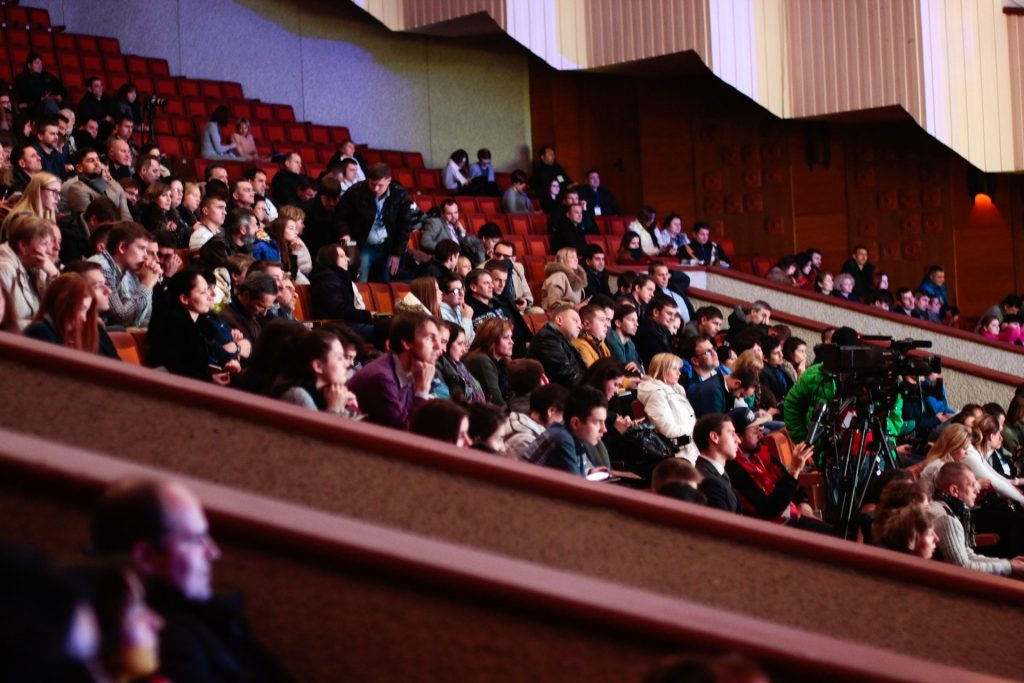 People listening at a conference.